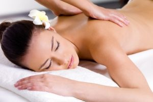 9195367 - beautiful woman having relaxing massage on her back in spa salon